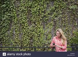 spring city park with a wall covered in climbing plants and ivy a