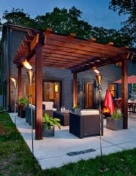 Tiki Patio Furniture by Clay Tiki Torches With Brown Siding Patio Contemporary And Modern