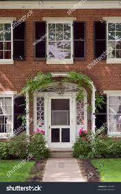 elegant looking front door ivy trellis stock photo 1315781