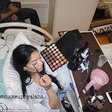 makeup artist equipment alaha majid applies a of make up while in labor in