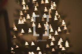christmas tree shaped lights tree shaped bokeh white lights on a christmas photo by maura