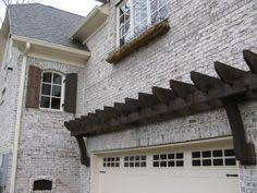 a trellis over a garage door adds a nice architectural feature to