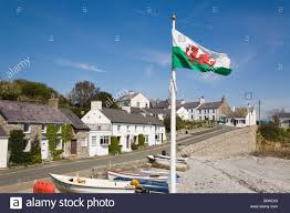 Beach Flag Pole Seafront Cottages Boats On Beach With Welsh Flag Flying In Small