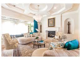 Earth Tone Colors For Living Room Wall Mount Tv Earth Tone Colors Tufted Sofa Open Shelves Media