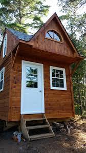 bala bunkie small cabin plan in a yard