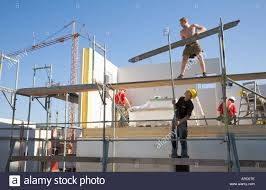 Prefabricated House Scaffolders At Work On A Prefabricated House Construction Site