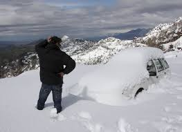 do i need to warm up my car in winter business insider snow covered car bemused driver mountain