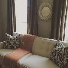 Orange Sofa Throw Porcupine Mirror Over Ivory Tufted Sofa With Orange Hermes Throw