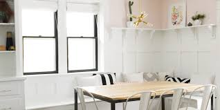 dining room white dining banquette with white chairs and wood