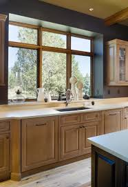 window sill kitchen transitional with cove lights brown cabinets