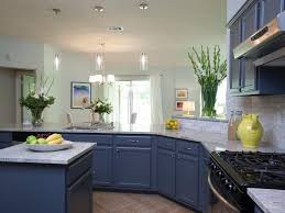 modern kitchen white appliances navy blue kitchen cabinet and kitchen island with marble top and