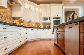 kitchen white cabinets brick backsplash radiant remodeling llc