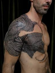 dotwork style cubic patterns and swallow tattoo on shoulder and