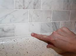 how to install a backsplash in the kitchen how to install a marble tile backsplash hgtv