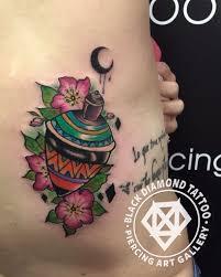 black diamond tattoo glyfada black diamond tattoo on twitter lady s spinning top tattoo