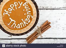 pumpkin pie with happy thanksgiving text stock photo royalty free