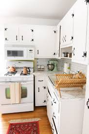 how to paint my kitchen cabinets white kitchen before after how i painted my kitchen cabinets