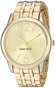 gold tone bracelet watches images Nine west women 39 s nw 1578chgb champagne dial gold tone jpg