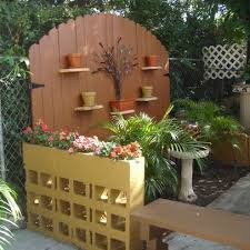 Cheap And Easy Backyard Ideas Gate Partial Privacy Fence And Cinder Block Planter Divider Wall
