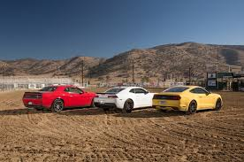 nissan gtr vs mustang ford mustang vs dodge challenger vs chevrolet camaro yellow car