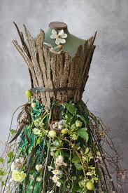 spring window display ideas a living spring dress and a corset made from bark from www