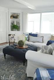 ottoman ideas for living room elegant living room features traditional fireplace under flatscreen