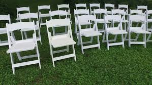 Bows For Chairs White Chairs With Pink Bows Waving In The Wind Wedding Decor For