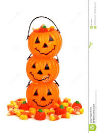 stack of halloween jack o lantern candy holders over white stock