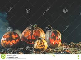 halloween pumpkins background halloween pumpkins at wood background carved scary faces of