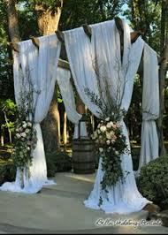 wedding arches rental vancouver green and white floral outdoor wedding ceremony white tulle