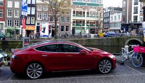 tesla model s charging file amsterdam charging red tesla model s jpg wikimedia commons