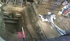 cellar and first layer of earthen floor building a cob house