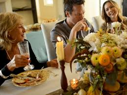 family at thanksgiving dinner host a friends giving your friends will be thankful for diy