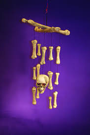 29 inch motion activated skull and bone windchime with spooky