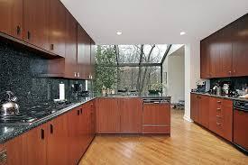 modern kitchen installed cherry wood cupboards and black