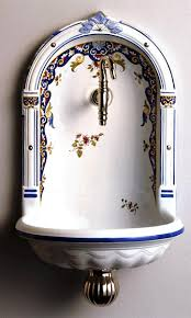 french country powder room accent niche fountain sink in vieux