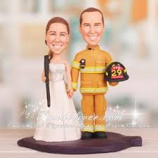 fireman cake topper hold shotgun and firefighter wedding cake toppers