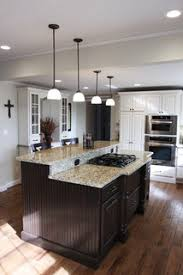what color cabinets go with venetian gold granite capitol collection new venetian gold