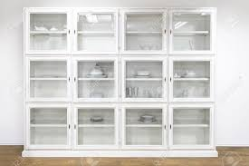 White Bookcase With Glass Doors by White Cupboard Display Cabinet With Glass Doors Stock Photo