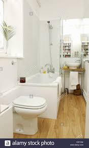 renovated flat interiimage of bathroom white mosaic tiling wood