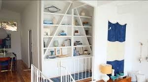 how to style a bookshelf with emily henderson style to sell 3