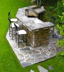 cuisine exterieure en cuisine exterieure en pierres avec barbecue evier bar