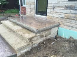 rock faced stamped concrete porch topping natural sandstone steps