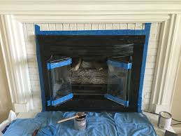 makeovermonday painting a brick fireplace and gold brassy