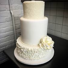 wedding cake ny a stunning white wedding cake with sugar ruffles floral and