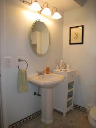how to decorate a guest bathroom white washstand and white wooden vanity on ceramics flooring