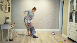 Vacuum Cleaners For Laminate Floors Woman Cleaning Using Vacuum Cleaner Effective Vacuum Cleaner