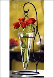 cute glass cone shaped decorative vase with roses and wrought iron