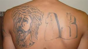 men upper back religious jesus face with thirteen number tattoo
