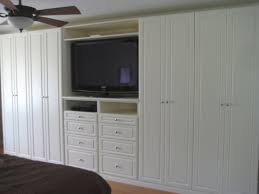 bedroom armoire tv one less closet on each side and drywall around we ve just
